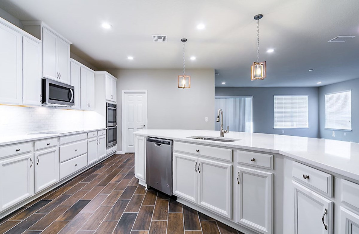 Redwood quick move-in Kitchen with large center island and white cabinets