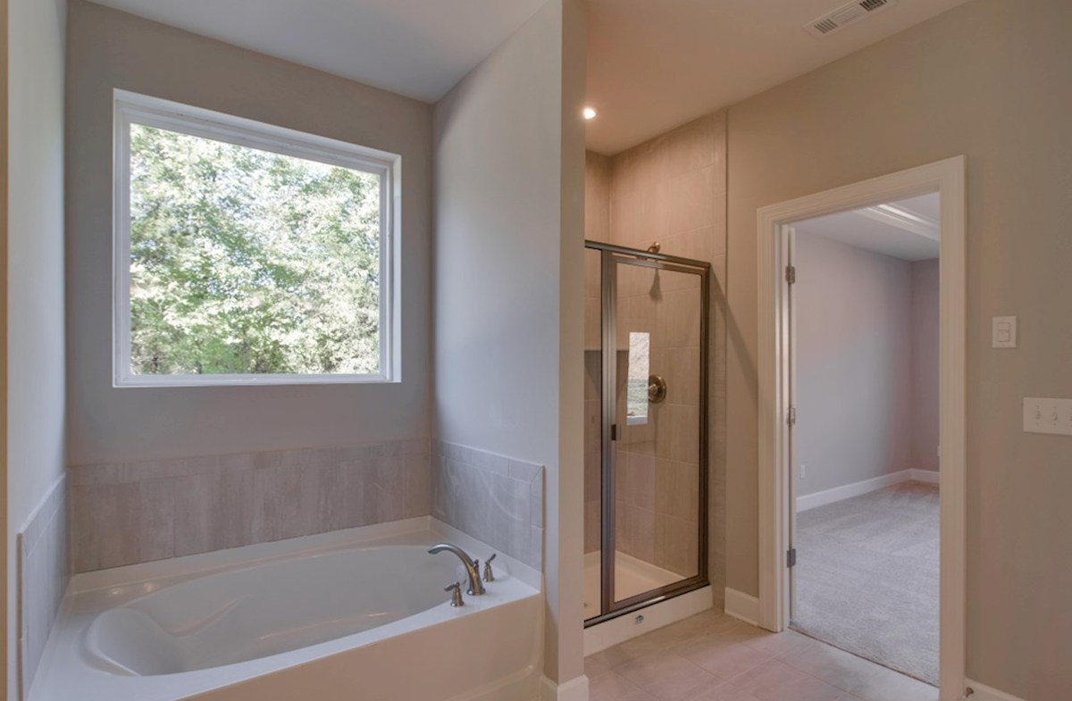 Dogwood quick move-in master bath with soaking tub and picture window