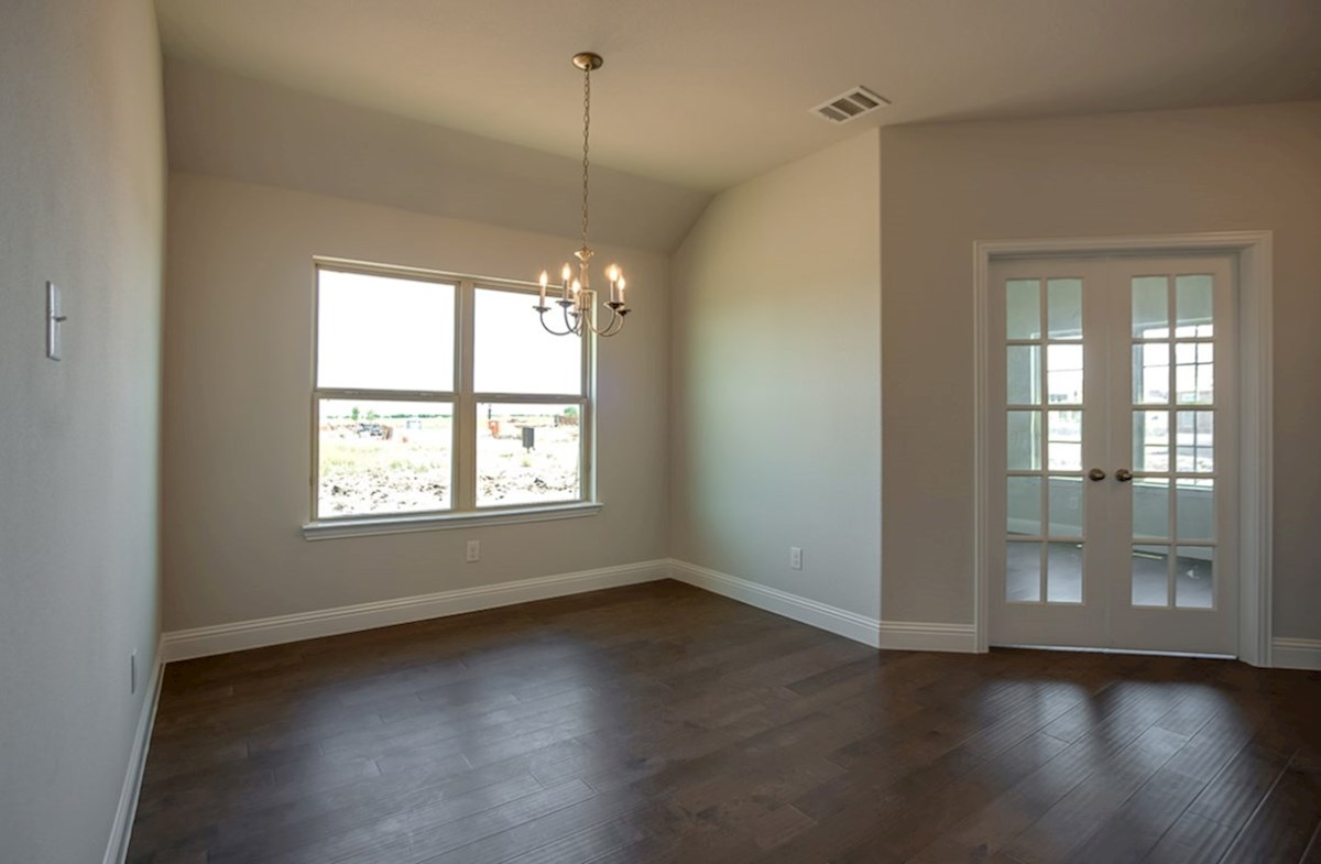 Millbrook quick move-in formal dining room and study with wood flooring