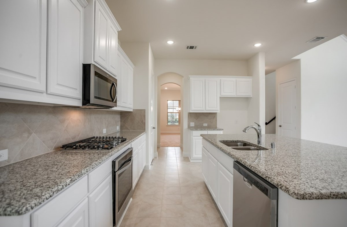 Whitney quick move-in kitchen with large island and white cabinets