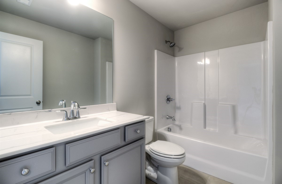 Spring Creek Place Georgetown Secondary Bathroom with gray cabinets