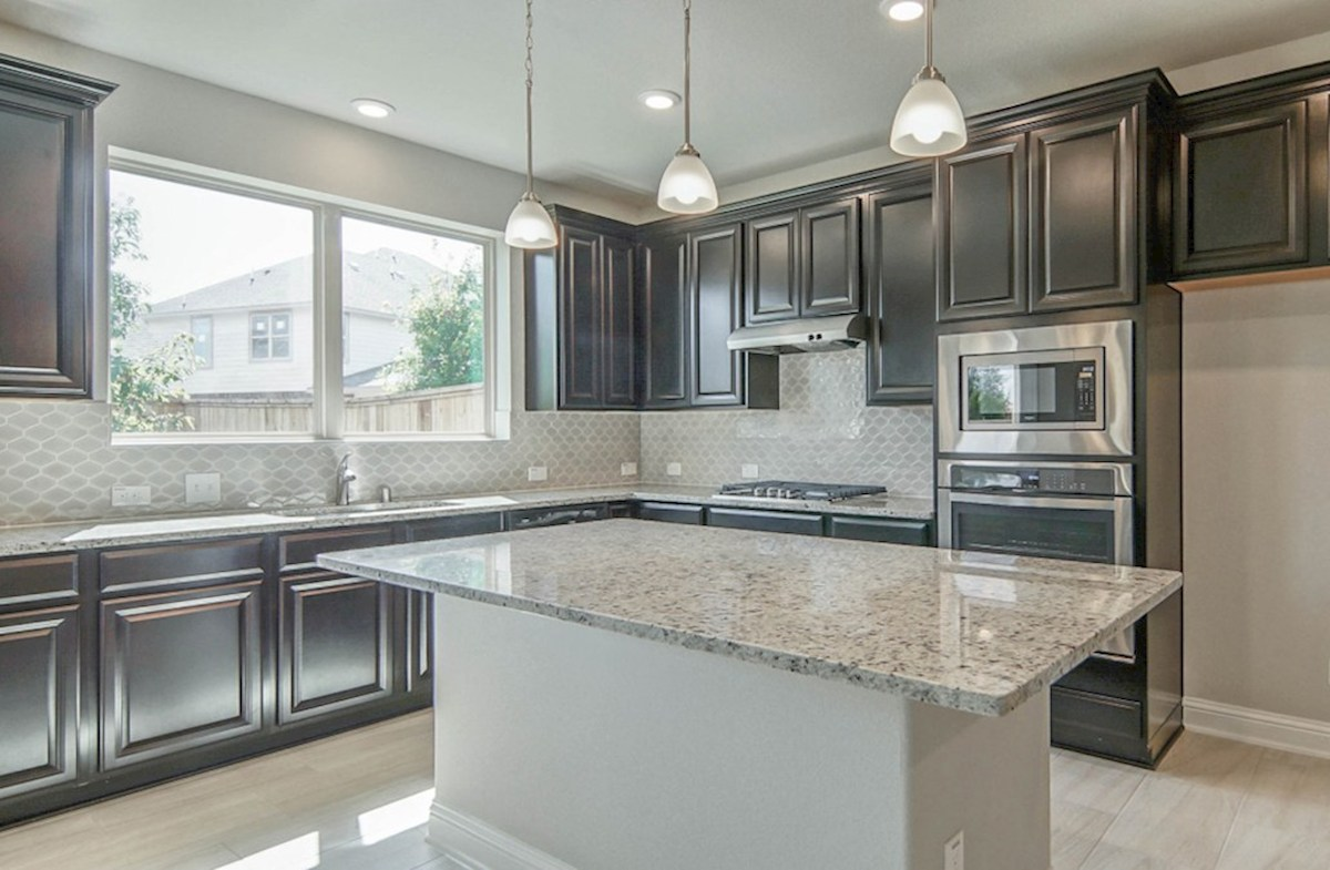 Sycamore quick move-in kitchen with granite island and tile floors