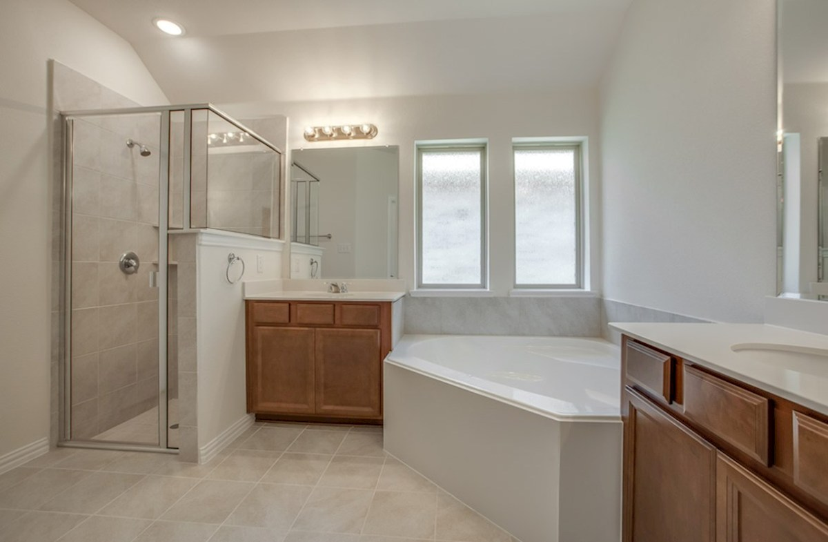Silverado quick move-in Silverado master bathroom with separate tub and shower