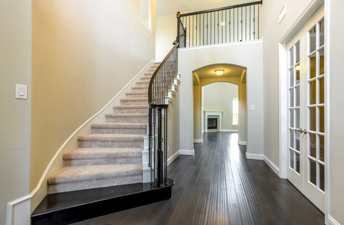 Trinity quick move-in entry way with decorative staircase
