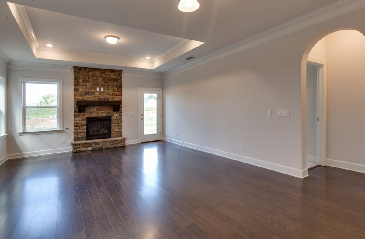 Oxford quick move-in great room with stone fireplace and hardwood floors