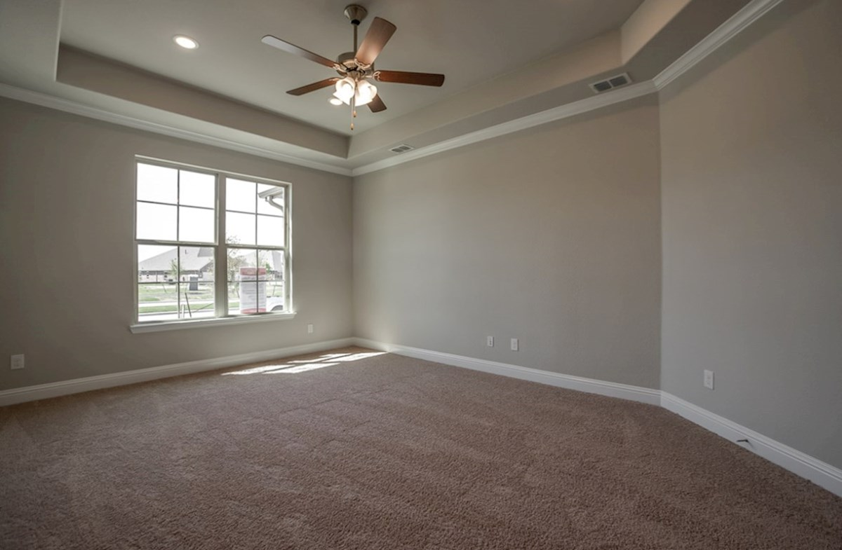 Blakely quick move-in master bedroom with tray ceiling