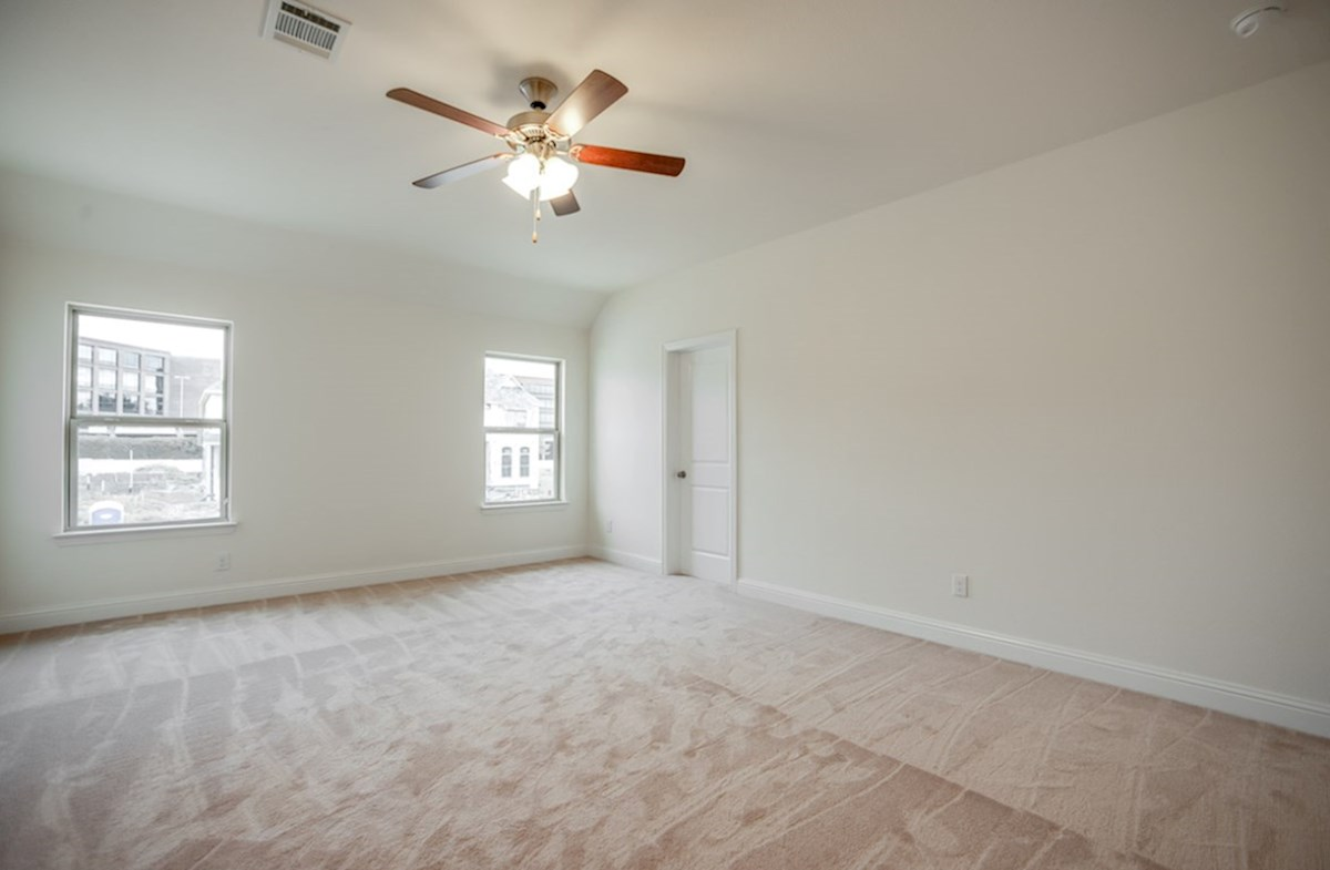 Whitney quick move-in master bedroom with ceiling fan and carpet
