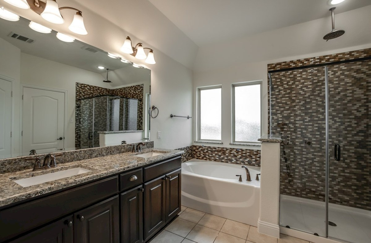 Whitney quick move-in Whitney master bathroom with separate tub and walk-in shower