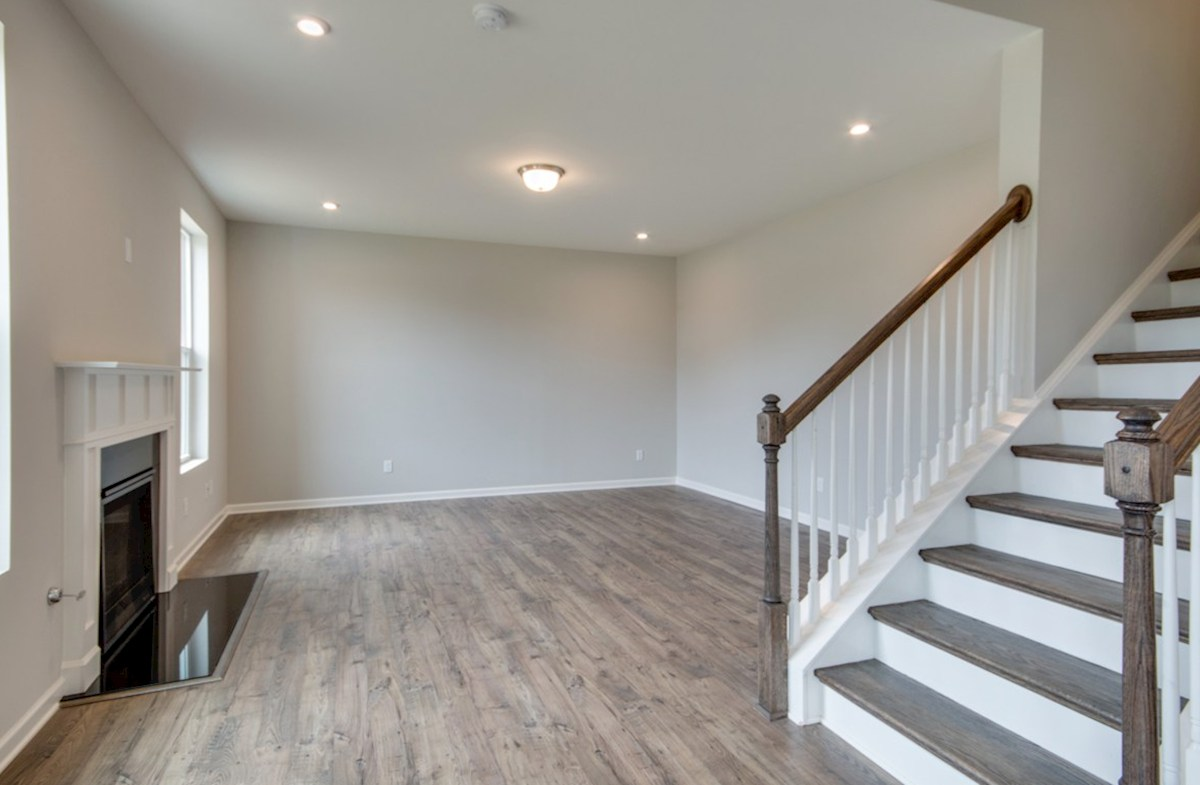 Ashford quick move-in great room with hardwood floors and fireplace
