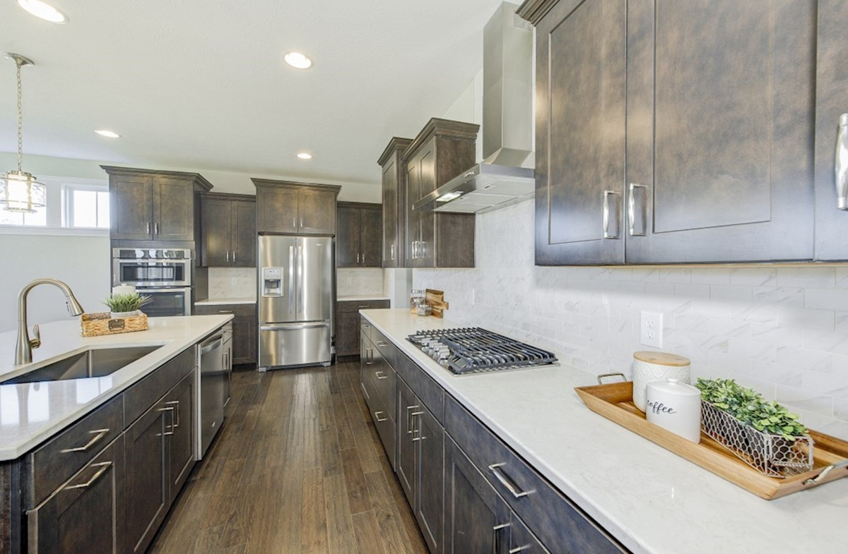 Hampshire Meridian Collection Keystone gourmet kitchen boasts quartz countertops