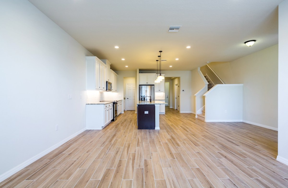 Champlain quick move-in Kitchen open to great room with wood-look tile