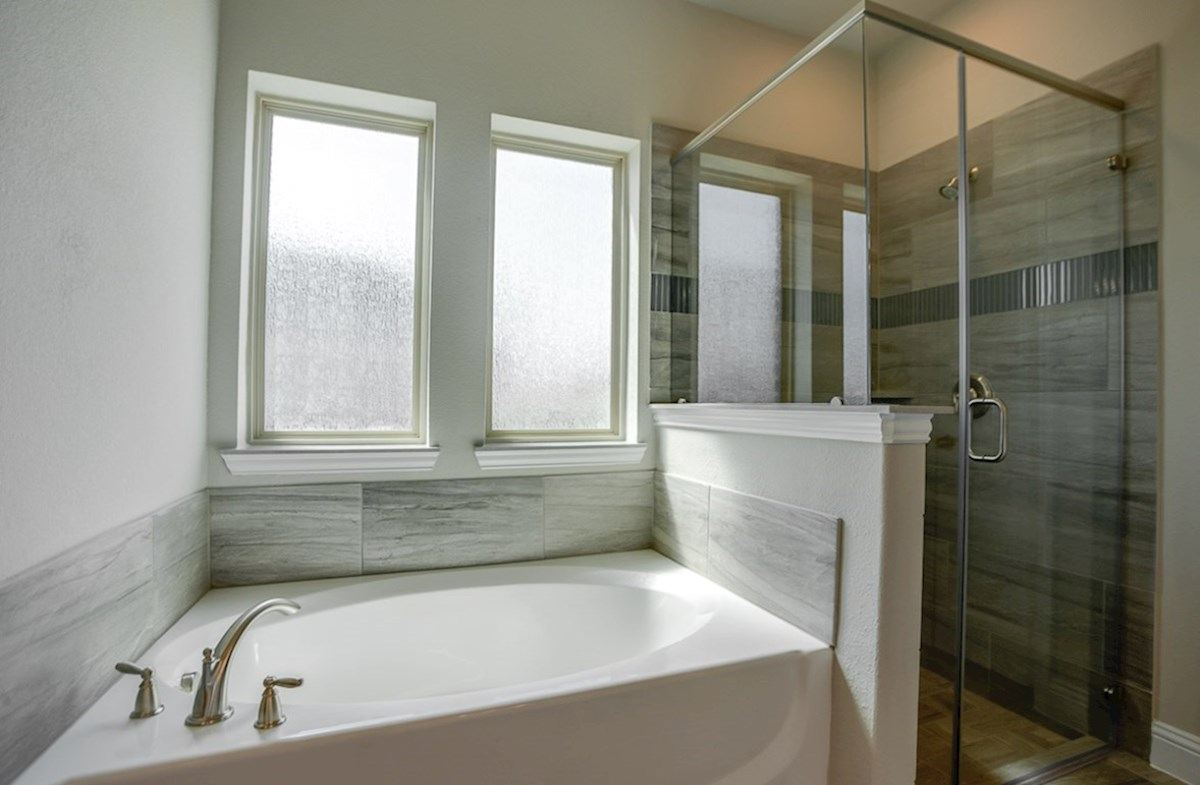 Brookhaven quick move-in master bathroom with soaking tub and walk-in shower