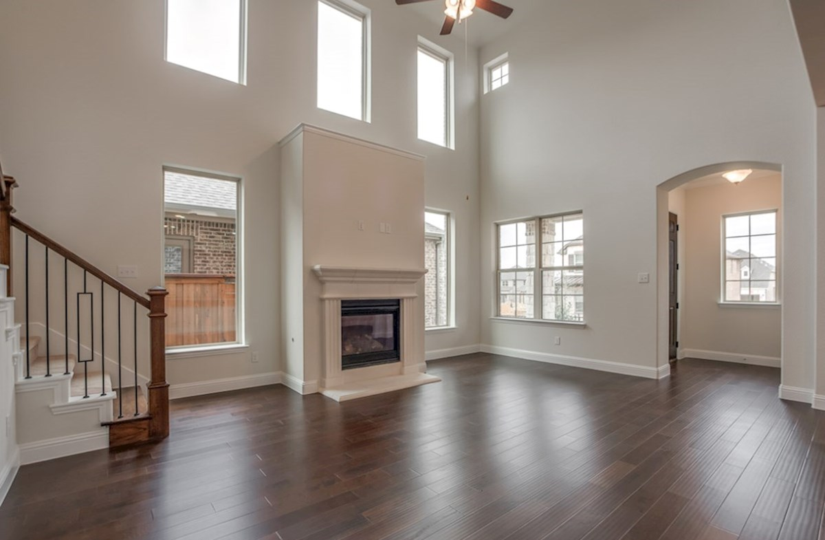 Brazos quick move-in open great room with wood floors and fireplace