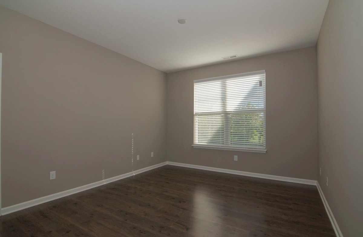 Summerland Park Hamilton spacious master bedroom with dark hardwood floors