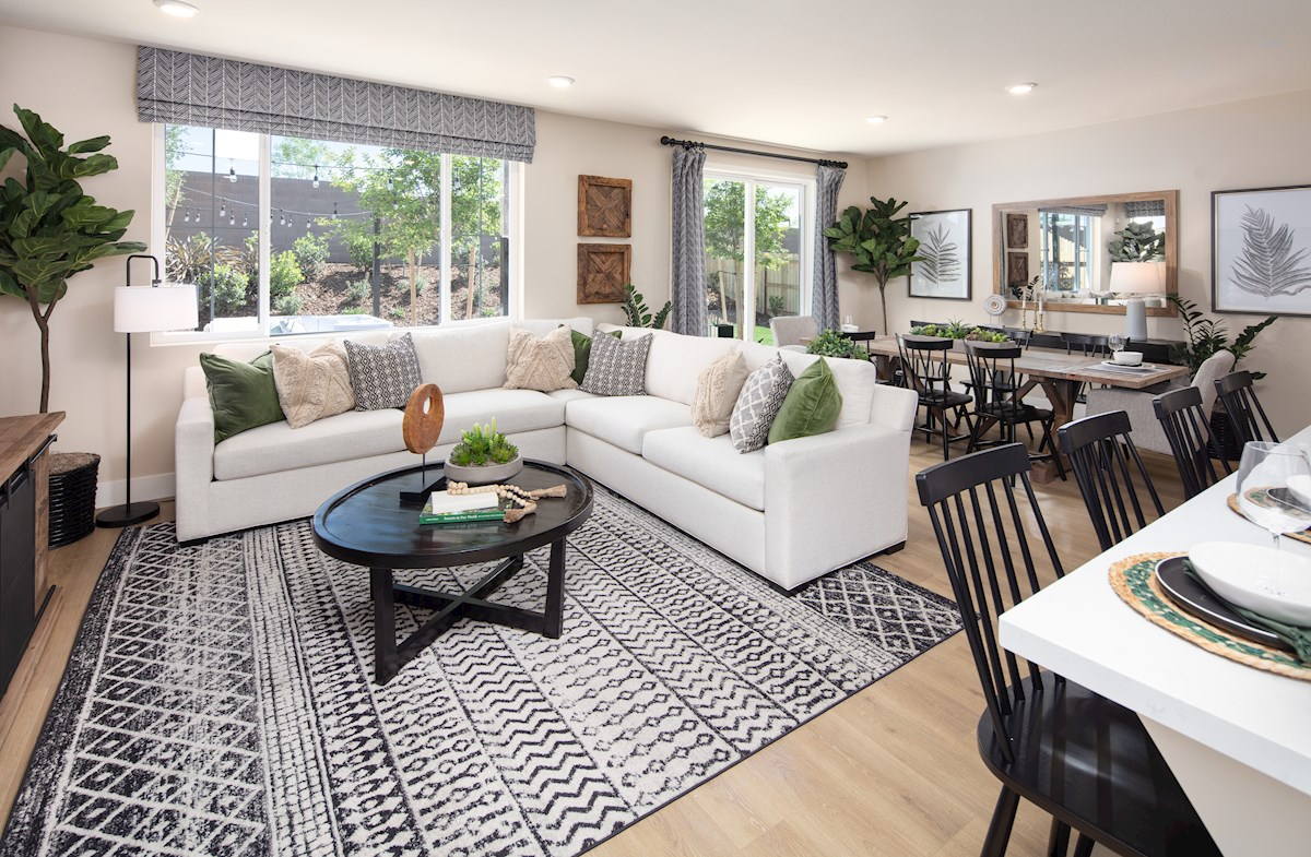 great room with sectional sofa, and large window