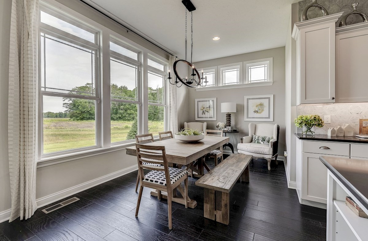 Hampshire Meridian Collection Delaware breakfast area with large windows and hardwood floors
