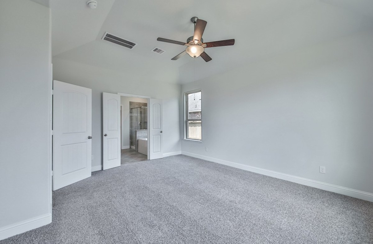 Biltmore quick move-in master bedroom with ceiling fan and carpet flooring