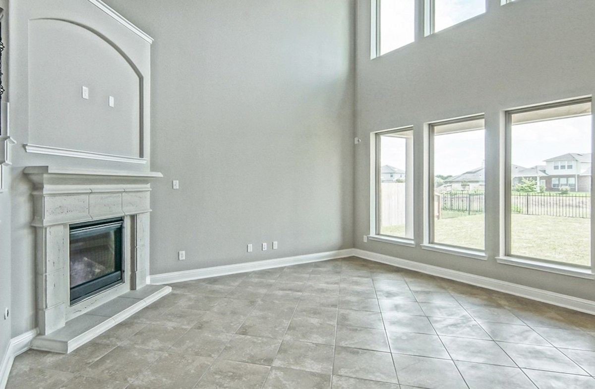 Armstrong quick move-in great room with fireplace and tile flooring