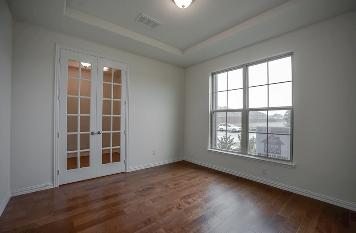 Silverado quick move-in study with French doors and wood floors