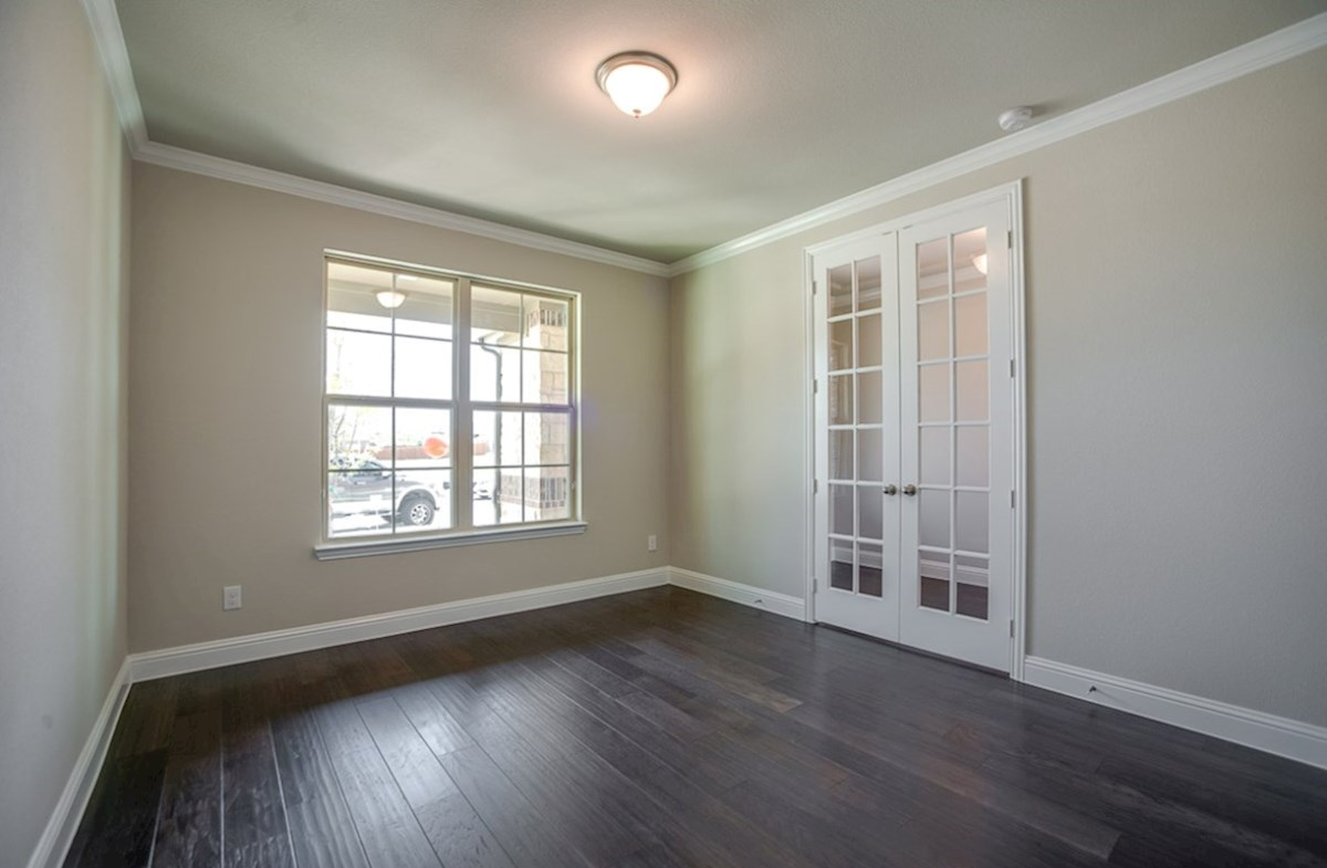 Brookhaven quick move-in study with wood floors and French doors