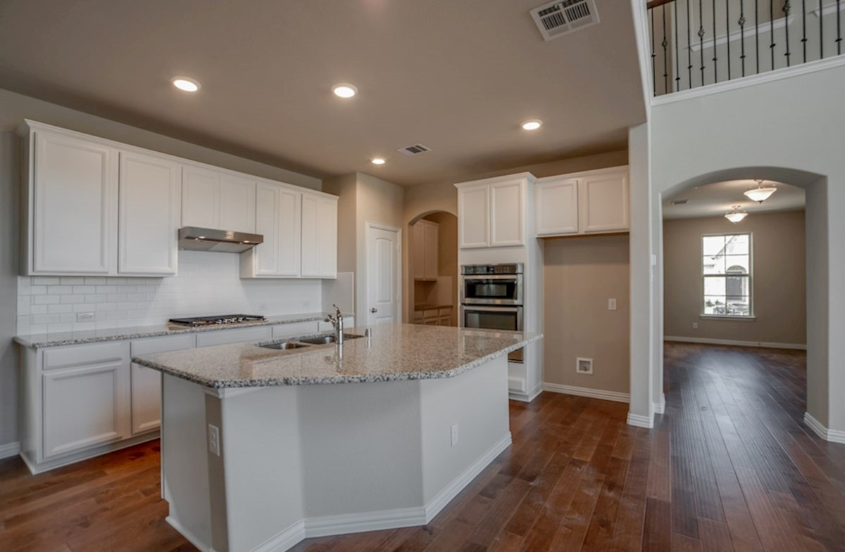 Fairfield quick move-in kitchen with white cabinets and large island