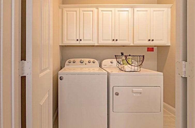 Wiltshire laundry room with upper cabinets