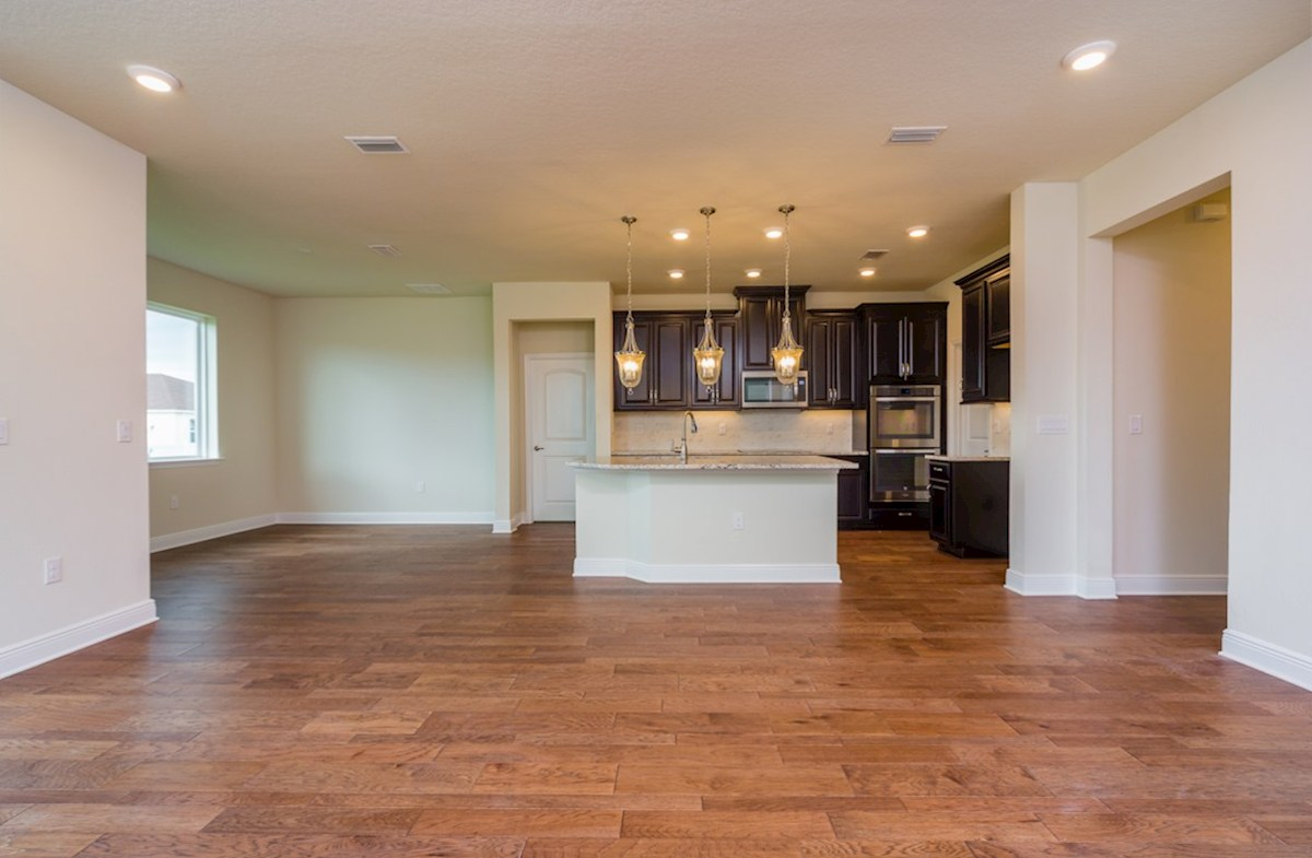 Sea Breeze quick move-in Great room and kitchen with engineered hardwood floors