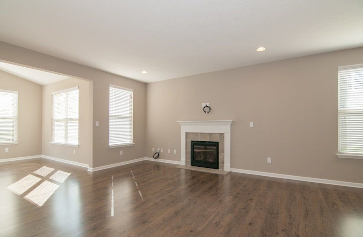 Heritage Trace Hamilton great room with fireplace and hardwood floors