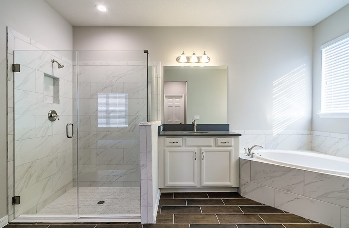 Redwood quick move-in master bathroom featuring white accents