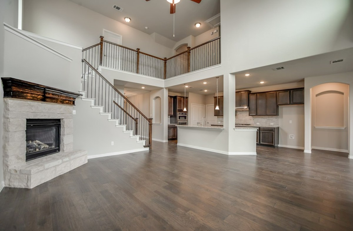 Brookhaven quick move-in open great room with high ceilings and stone fireplace