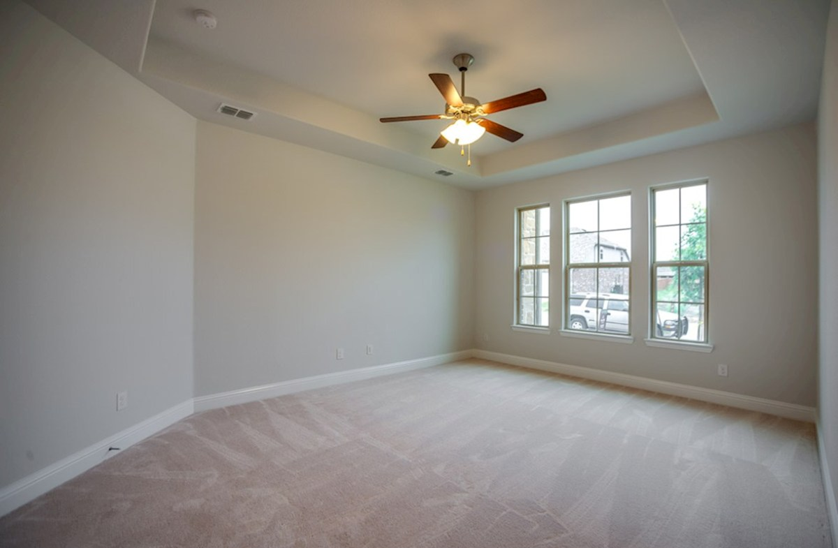 Blakely quick move-in master bedroom with tray ceiling and carpet