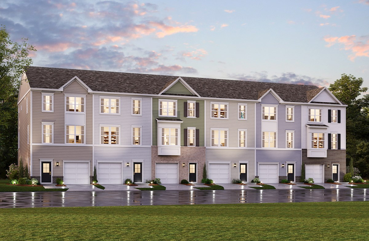 dusk exterior rendering of townhomes