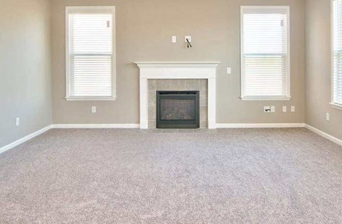 Whitley quick move-in Great room offers a cozy fireplace