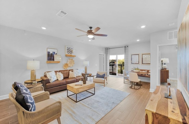 Clifton great room with wood-like tile and ceiling fan
