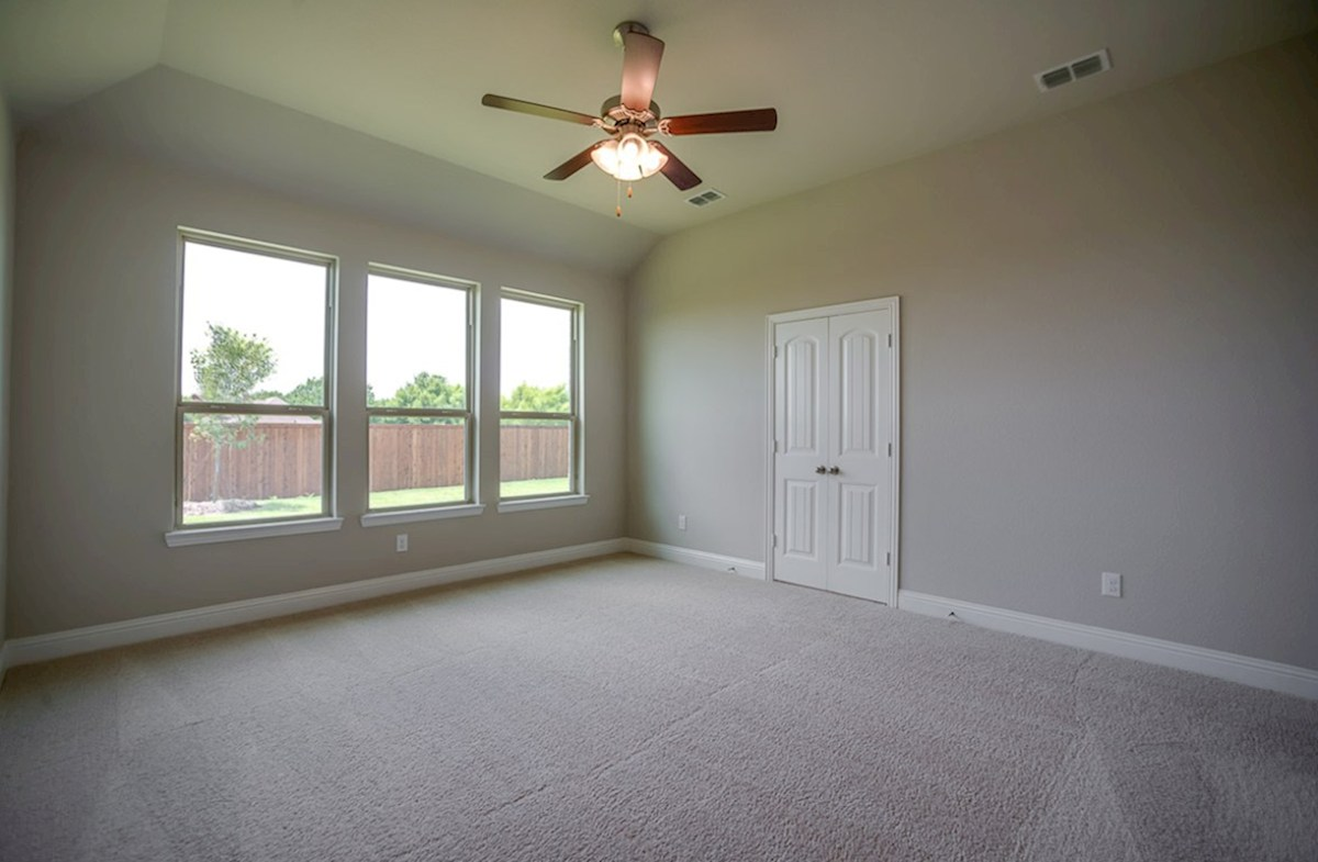 Covington quick move-in Tall ceilings & windows accentuate the master in this quick move-in home