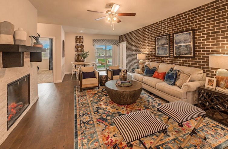 Clifton great room with cozy fireplace and brick accent wall