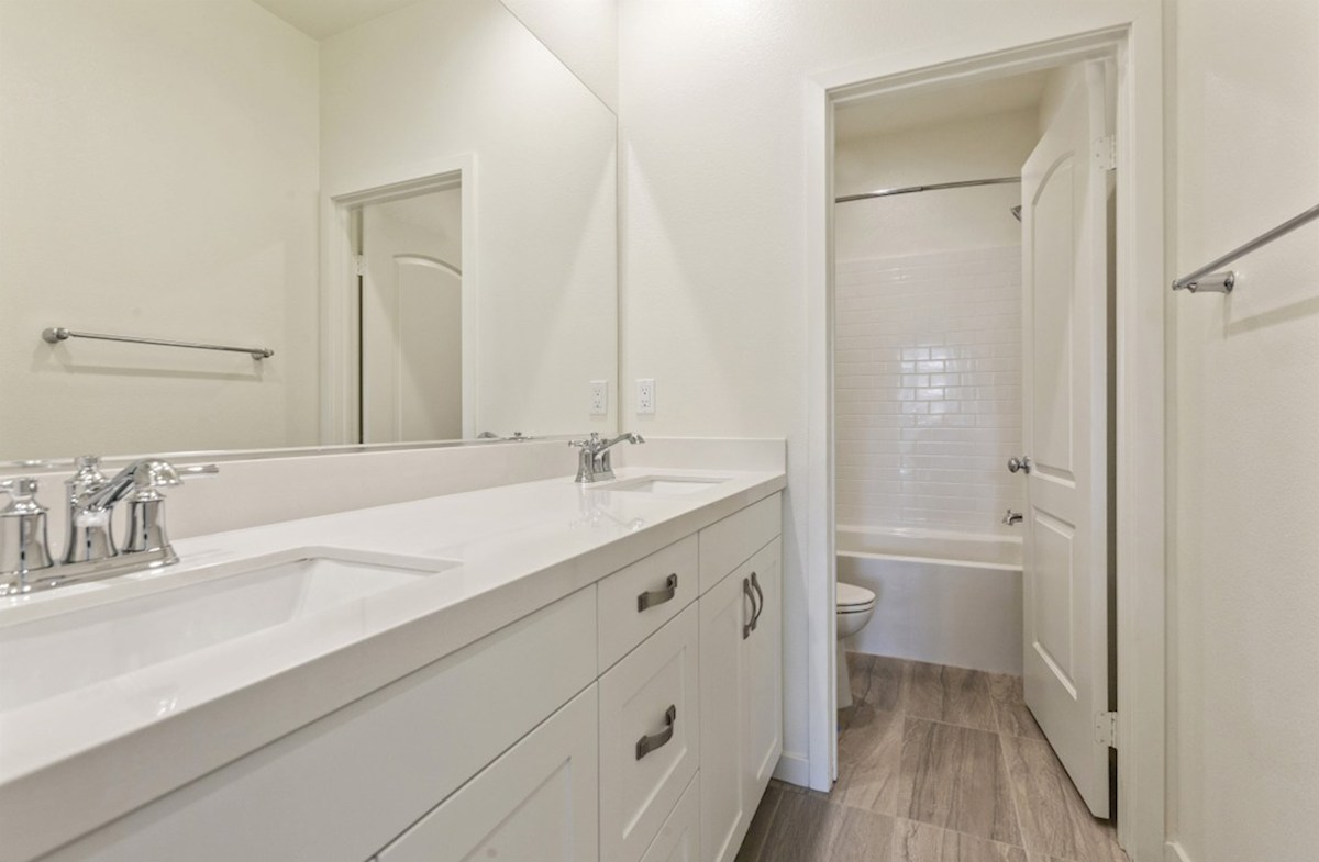 Daffodil quick move-in Secondary bathrooms with abundant storage space