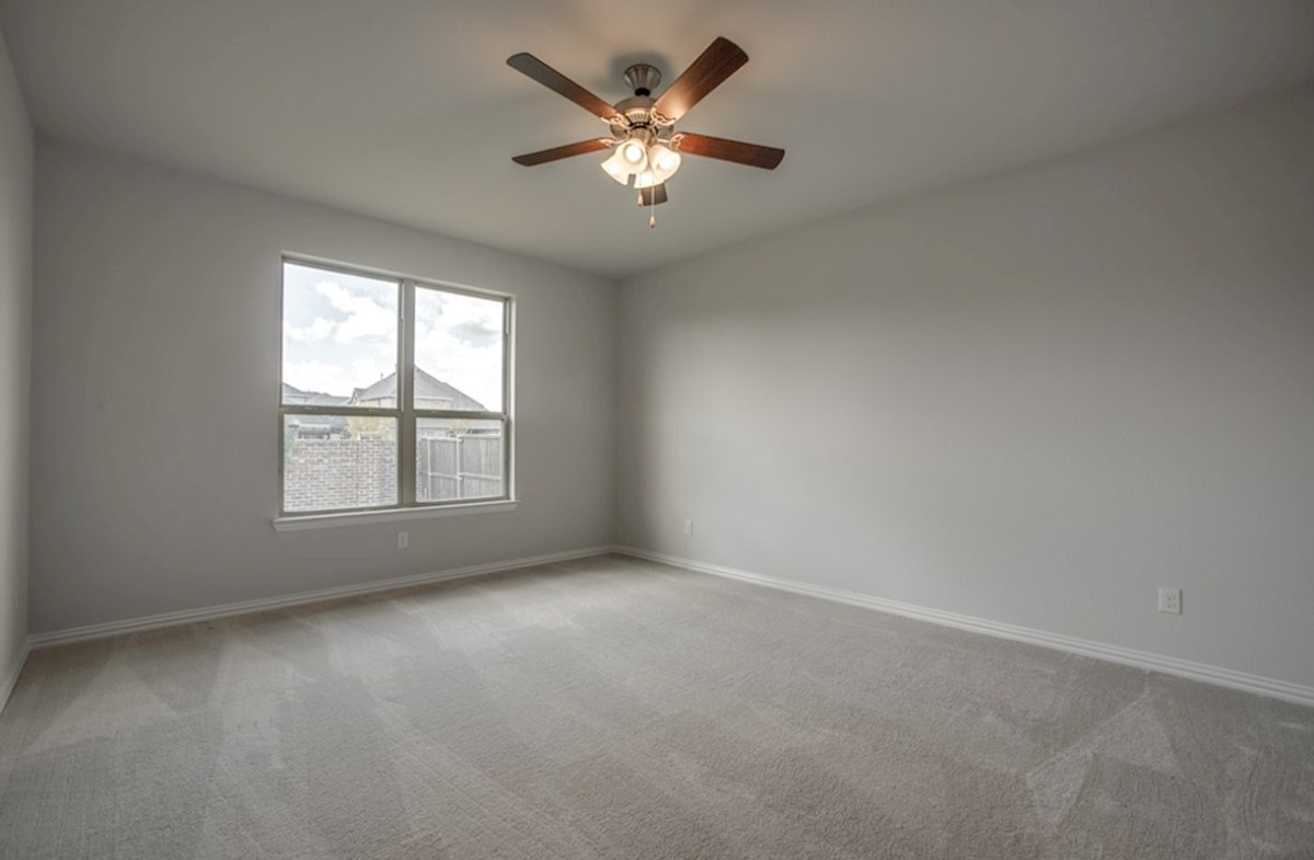 Avalon quick move-in master bedroom with carpet and ceiling fan