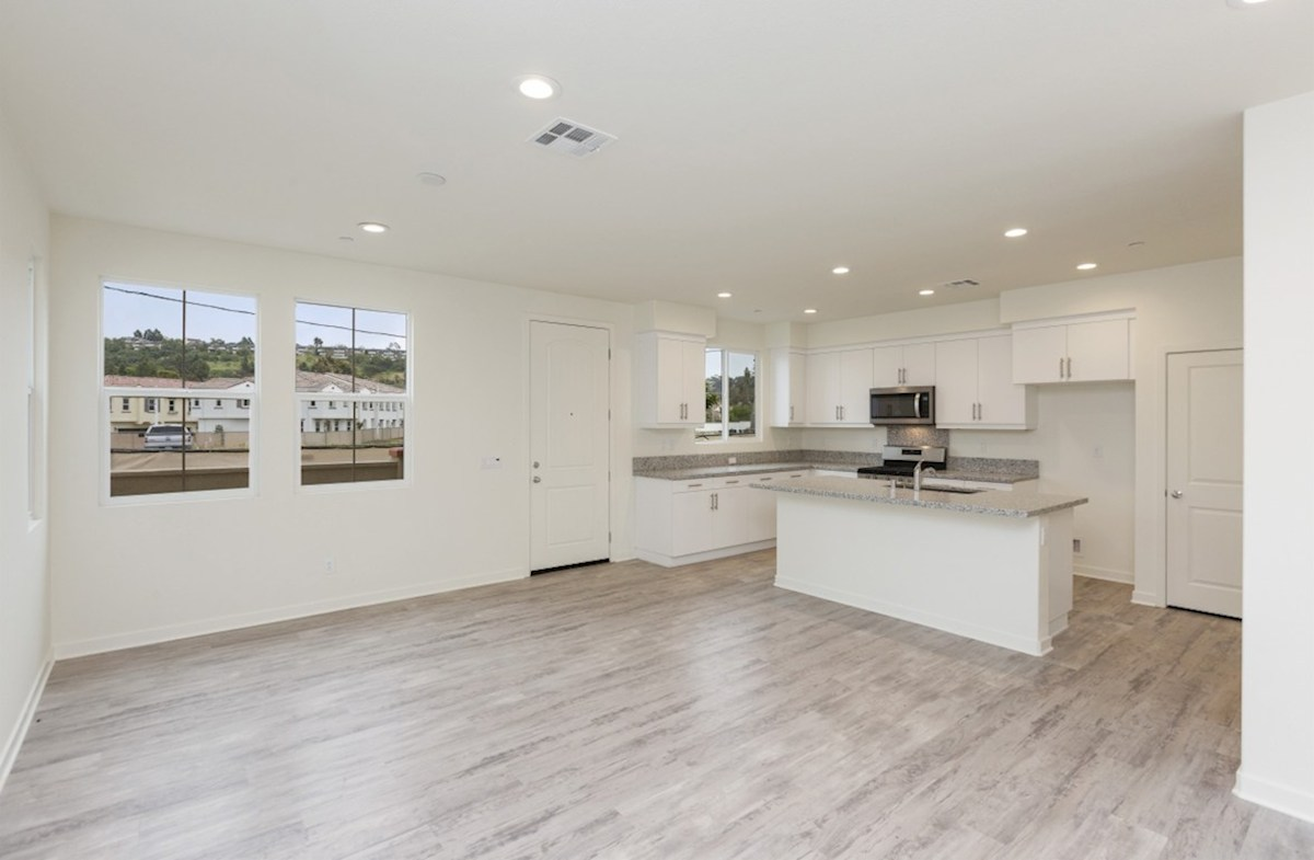 Pinyon quick move-in Entertain guests while preparing gourmet meals in this open-concept kitchen and great room