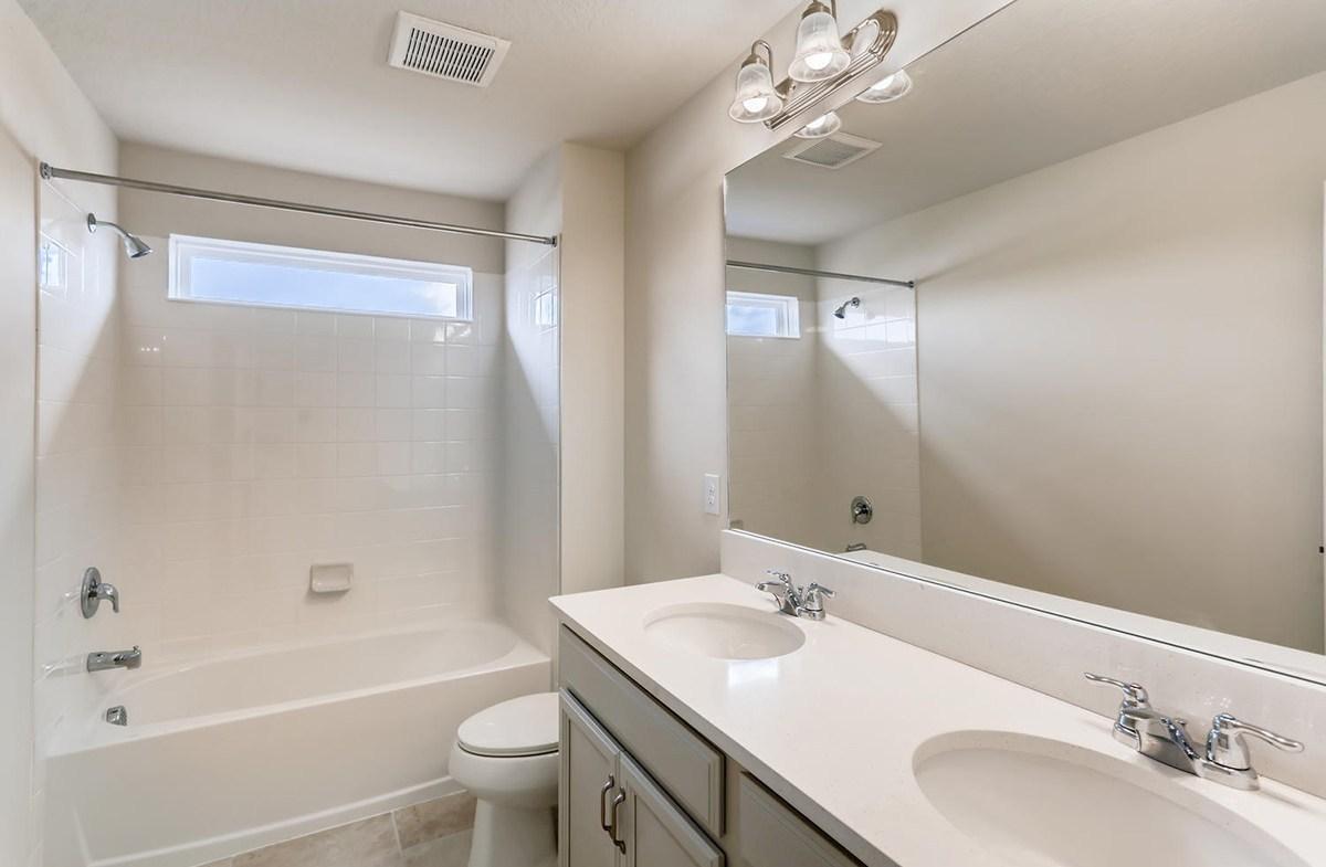 Reserve at Citrus Park Estero Secondary bathroom with dual sink vanity