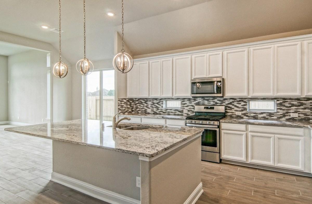 Capri quick move-in kitchen with pendant lighting and granite countertop
