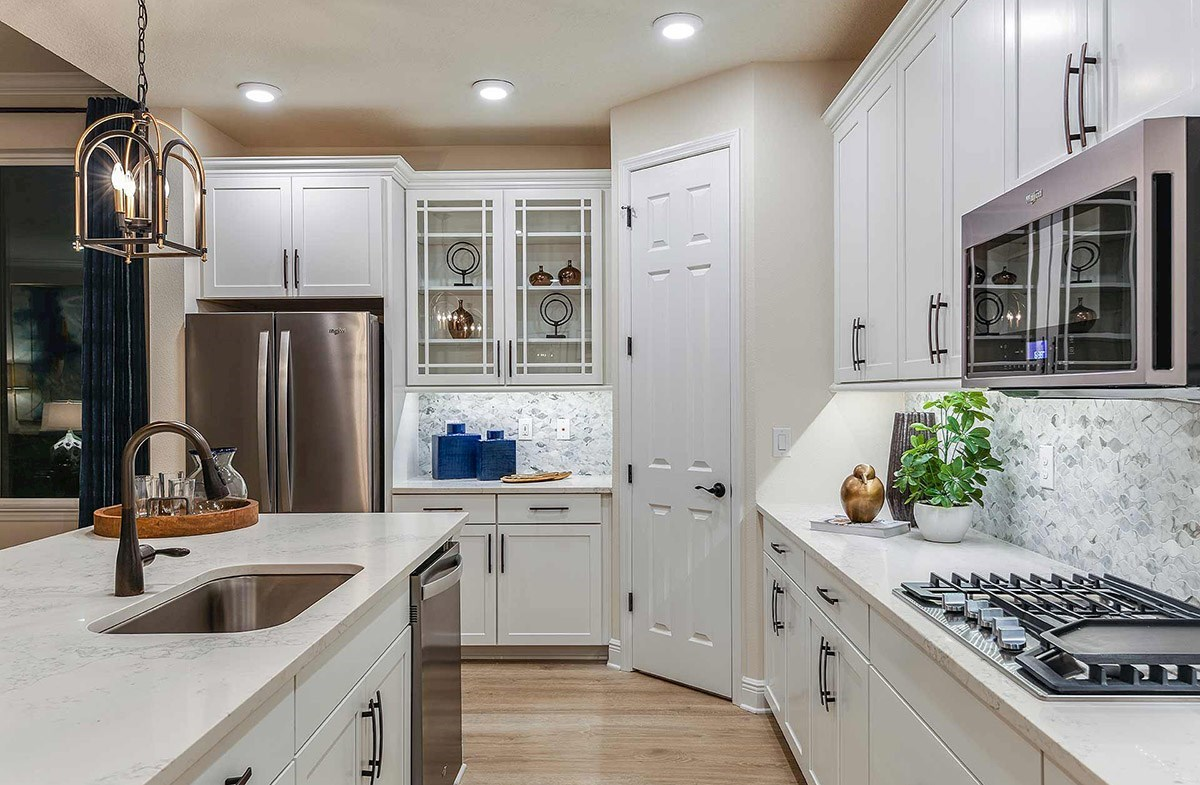 Waterset Bayview Open kitchen with white cabinets