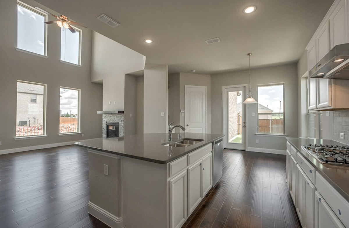 Fairfield quick move-in open kitchen with large island and white cabinets