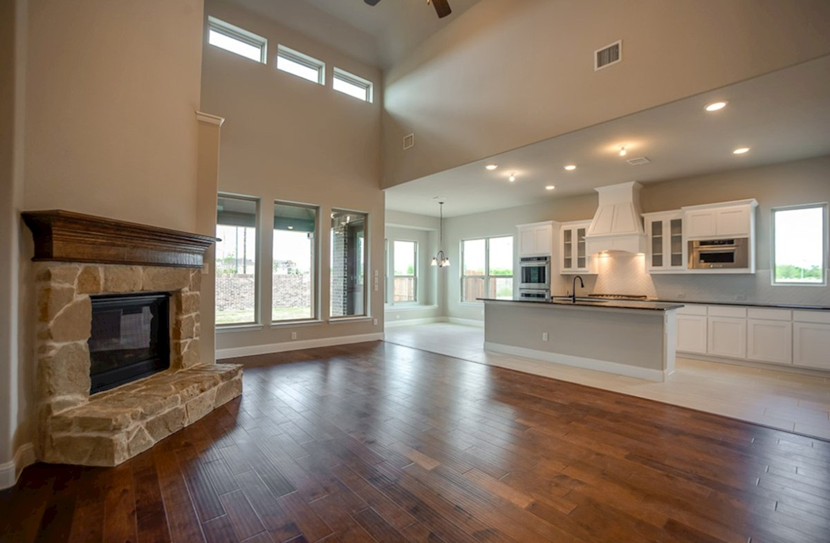 Summerfield quick move-in open great room with stone fireplace