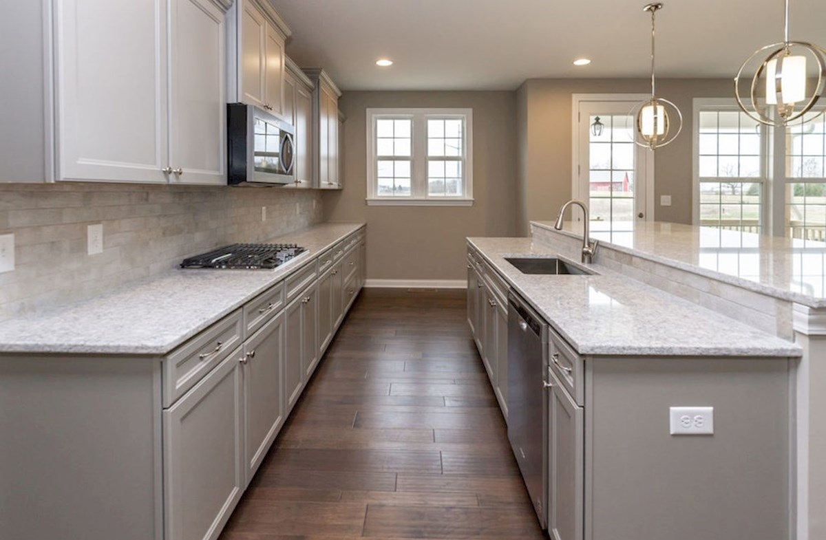 Hampshire Meridian Collection Oakhill gourmet kitchen with quartz countertops