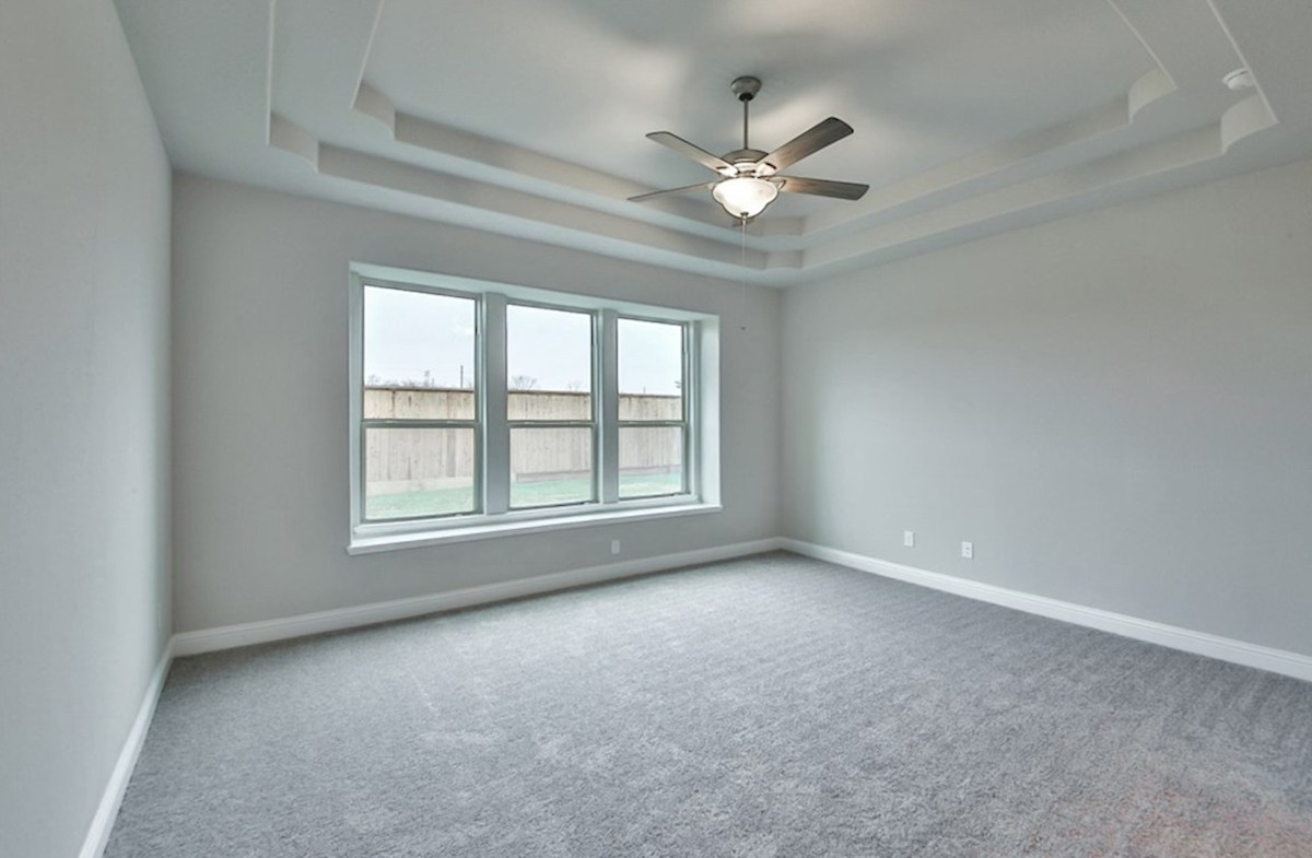 Caldwell quick move-in master bedroom with carpet and window seat