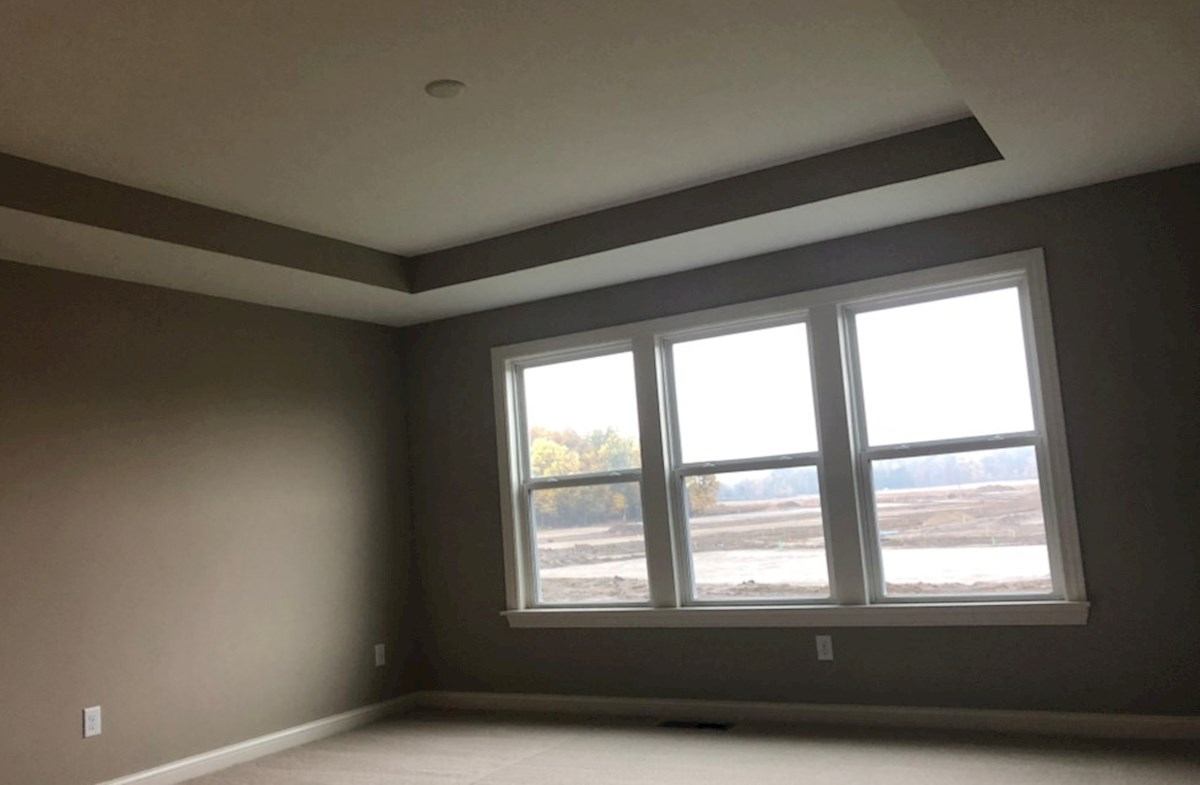 Oakhill quick move-in Master bedroom with trey ceiling