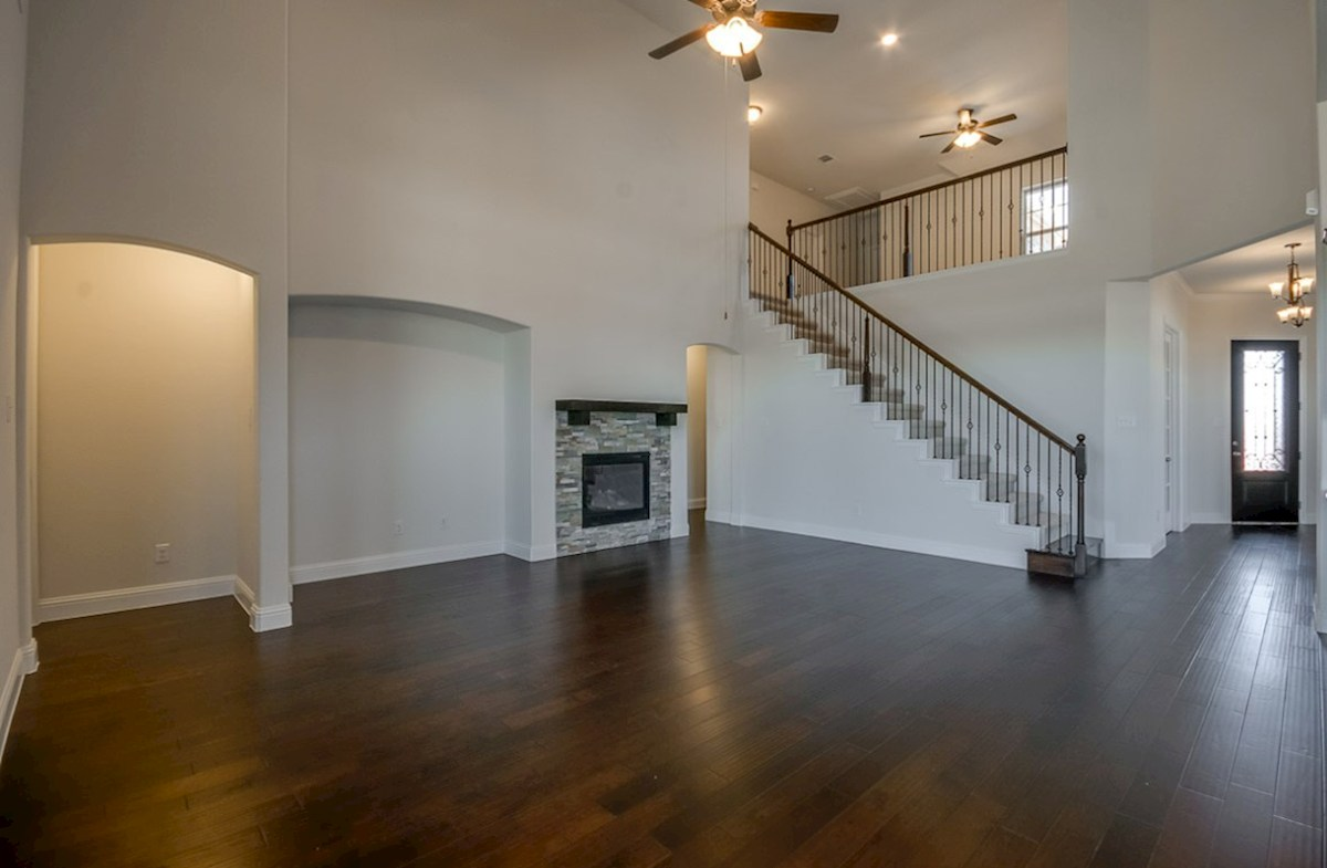 Kerrville quick move-in open great room with wood floors and stone fireplace