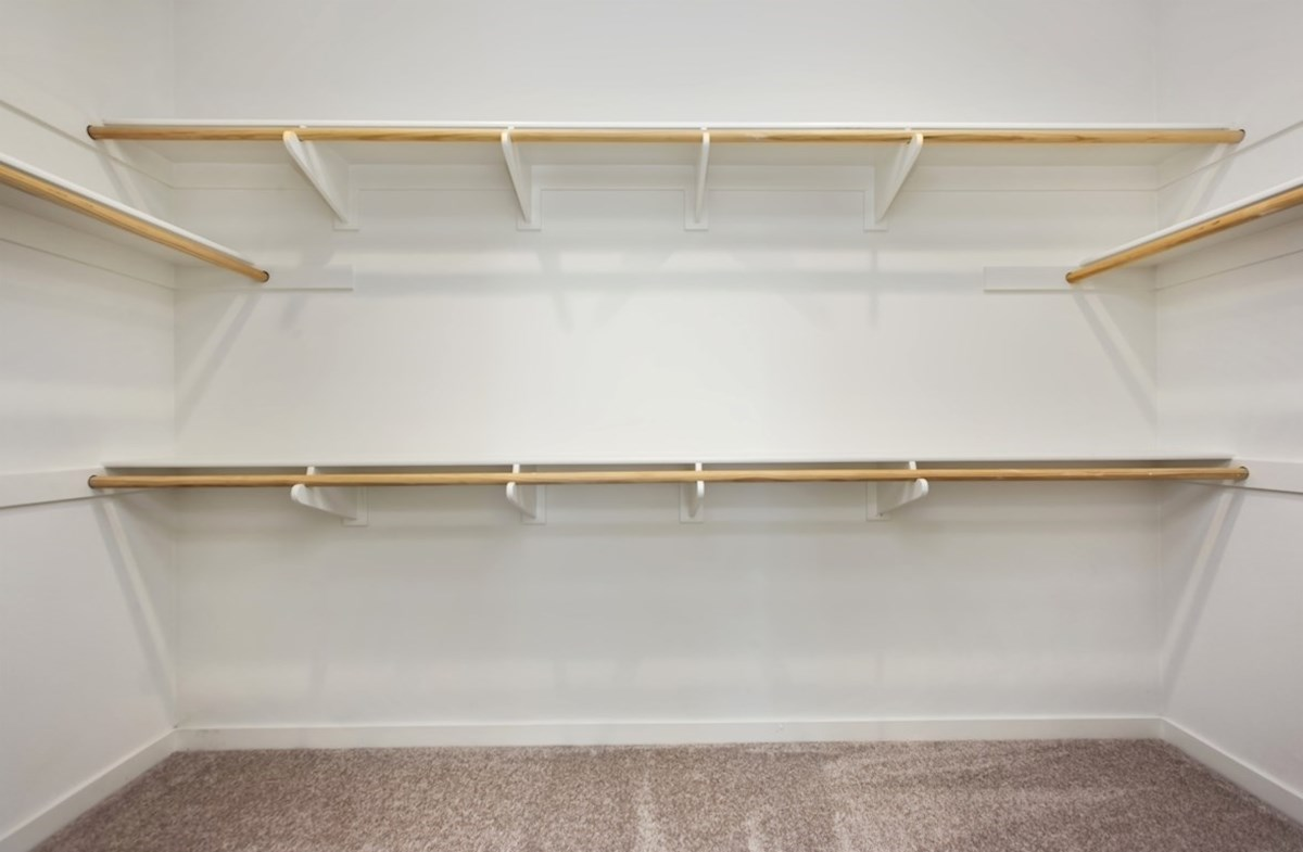 Napa quick move-in Walk-in closet is designed for easy movement between shelves and optimal hanging and storage space.