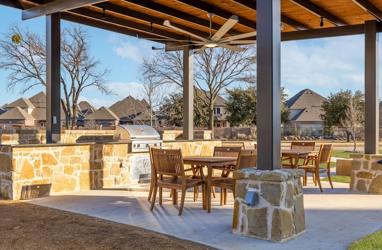outdoor grill with covered seating area